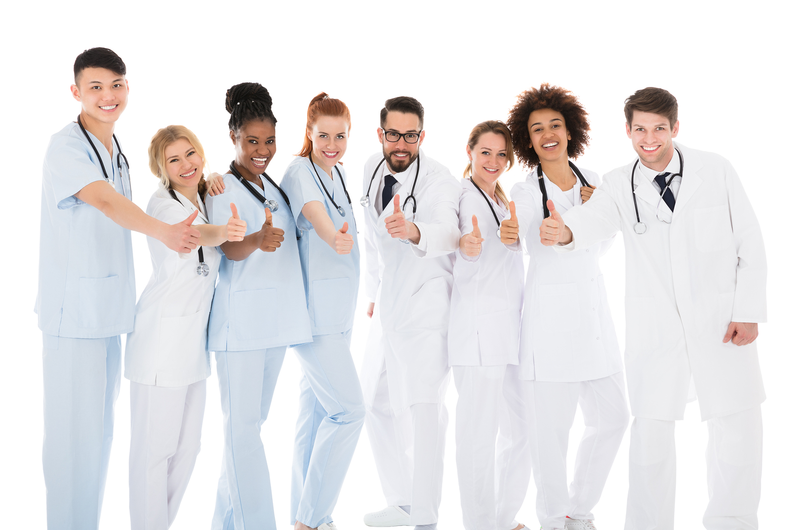 Group Of Medical Team Gesturing Thumbs Up Over White Background
